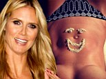 Getting creative! Heidi Klum Tweets a topless shot with a smiling sand and shell face adorning her enviable washboard stomach