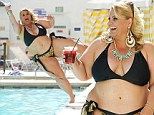 Making a splash! Ajay Rochester shows off her voluptuous figure in a leopardskin print bikini as she enjoys a wet and wild weekend in Vegas