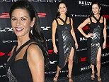 Catherine Zeta-Jones shows off her toned legs in a daring black strappy dress at NYC Red 2 screening