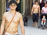 As if it wasn't hot enough already! Orlando Bloom raises temperatures as he goes shirtless for stroll with son Flynn