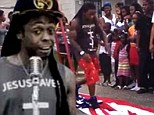 Change of heart: Lil Wayne has cut out the trampling of the American flag from his God Bless Amerika video