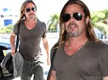 Fit Pitt! Brad shows off his muscly torso through a tight sheer T-shirt as he jets out of LAX