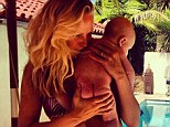 Lucky me: Malin Akerman enjoyed a day by the pool with her son Sebastian on Tuesday