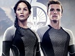 Let the Hunger Games begin! New Catching Fire posters show Jennifer Lawrence and costar Josh Hutcherson suited up for battle in skintight body suits
