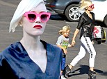 A rose-tinted view! Gwen Stefani dons flashy pink sunglasses as she drops son Zuma off at school