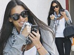 Must be those endorphins! Demi Moore looks relaxed and happy as she flashes a grin after yoga class