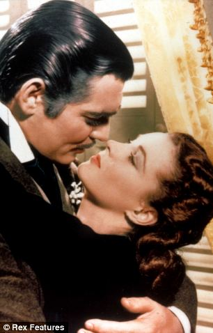 Vivien Leigh kissing Clark Gable in Gone With The Wind