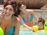 Her smile says it all! Bikini-clad Farrah Abraham frolics in the pool with daughter Sophia after earning over $100,000 in royalties from sex tape