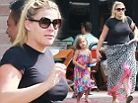 Embracing her new mom curves: Busy Philipps bucks the trend to slim down in record time as she enjoys her first family outing with baby Cricket
