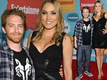 Mini me: A smiling Seth Green does not let his short comings get him don as his glamorous wife towers over him