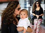 Babe in arms: Doting mom Camila Alves is the picture of maternal perfection as she cradles son Livingston during LA outing