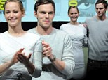 The couple that works together! Nicholas Hoult keeps a tight grip on 'newly reunited' love Jennifer Lawrence alongside their X-Men co-stars at Comic-Con