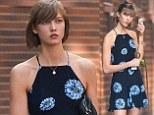 A floral delight! Supermodel Karlie Kloss is a long-stemmed, make-up free bombshell as she treats her pooch to a leisurely stroll
