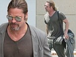 Brad Pitt making last minute plans for his wedding to Angelina Jolie seems to have forgotten a change of clothes arriving at LAX in the same outfit he left in