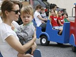 All aboard the fun express! Alyssa Milano treats cute son Milo to a train ride on a day out at the farmers' market