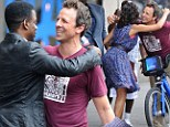 Fancy seeing you here! Seth Meyers shares a hug with fellow SNL alum Chris Rock and Rosario Dawson as he bumps into actors during bike ride with fiancee Alexi Ashe