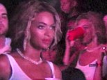 Just like any other concert goer! Beyoncé sips out of a red plastic cup as she dances in the crowd at husband Jay Z's concert