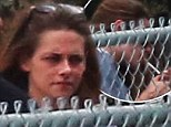 In need of a nicotine fix: Kristen Stewart decides to de-stress with smoke break after looking typically moody on Camp X-Ray set