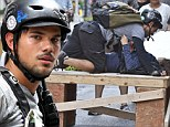 Taylor Lautner caught in compromising position with rumoured love interest Marie Avgeropoulos...but it's just a scene for their new film
