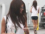 Too sexy for her sandals! Selena Gomez steps out in knee high Gladiator shoes and hotpants... a day after devilish birthday celebration