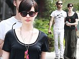 Trading high fashion for floppy fabrics! Anne Hathaway drowns in heavy floor-length skirt and sloppy T-shirt on lunch outing with husband Adam Shulman