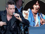 Want to be as big as Elvis, Robbie? Bloated pop star bears resemblance to King in later years as he takes the stage
