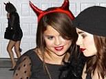 Birthday shenanigans: Selena Gomez dons cheeky devil horns as she celebrates her milestone 21st birthday with pal Lily Collins