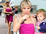 My precious petal! Elsa Pataky snuggles up to baby India Rose on family lunch