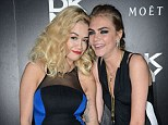 As they were: Rita Ora and Cara Delevingne pose in June at the DKNY Artworks Launch, London