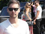 Family man: Tobey Maguire enjoyed a cool drink and time with the family on Saturday in West Hollywood, California