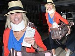 Smiling Kristin Chenoweth heads to departing flight STILL wearing a neck brace 13 months after fracturing her skull