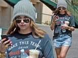 Bad hair day? Ashley Benson wears thick knit cap with her jean shorts in 76-degree sunshine