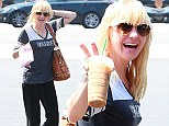 This is not a scary movie! Anna Faris sports a frightening mess of wet blonde hair for early morning coffee run