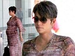 Maxi-mum (to be) points for effort! Pregnant Halle Berry looks stylish in a flowing dress