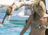 She's a tribal girl! Kate Moss wears a cheetah-print bikini and a gold armband before diving into the sea