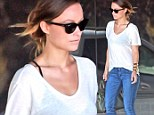 Trend follower: Olivia Wilde wore a black bra underneath her sheer white T-shirt while out in Los Angeles