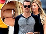 'Best night of my life. We're on top of the world!': Ashley Tisdale flashes her engagement ring after boyfriend Christopher French 'proposes to her'