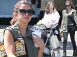 Selena Gomez bares her taut midriff in black crop top and skinny jeans to bond with mother Mandy and baby sister Gracie