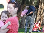 Don't drop her! Alyson Hannigan and her husband have a rough-and-tumble play date with their daughters in the park