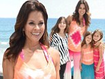 Feeling groovy! Brooke Burke-Charvet channels her inner hippie in a pink and orange tie-dyed matching two-piece