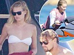 Bored already? Leonardo DiCaprio and new girlfriend Toni Garrn look glum aboard multimillion dollar yacht before model takes to the sea on a jet ski