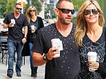 Hand-in-hand: Heidi flashes a smile as she walks with boyfriend Martin as they leave a Brentwood, California Starbucks on Saturday