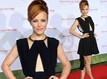 Baring it all! Rachel McAdams flashes some skin in a revealing abstract black pleated dress at German premiere of About Time