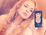 '#back@work!' Lindsay Lohan marked her step back into professionalism by uploading this selfie on Wednesday