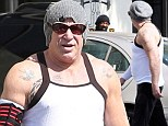 Pumping extra iron? Mickey Rourke sports bulkier frame in tight vest after workout at iconic bodybuilder gym