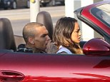 Ride of his life: Karrueche Tran drove Chris Brown around on Tuesday in his red Porsche