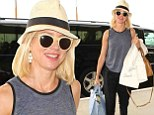 Flying in style: Naomi Watts looked chic as she arrived at LAX on Wednesday