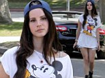How old are you again? Lana Del Rey strolls back to her childhood in Mickey Mouse T-shirt and cut-off shorts to meet a friend