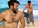 The Great Gatsby star Joel Edgerton shows off his muscular physique as he goes shirtless for an early morning swim