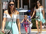 Adriana Lima has her hands full as energetic daughter Valentina breaks into a run on family day out